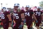 members of the SIU football team head to the stadium