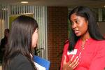 A business student speaks with a recruiter.