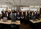 Members of Saluki Student Investment Fund stand in the Kraft Trading classroom