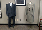 a man's and a woman's dress suit displayed on two mannequins